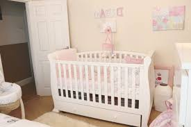 modern baby girl nursery ideas round pink rug boat baby crib mobile tree branch wall decal