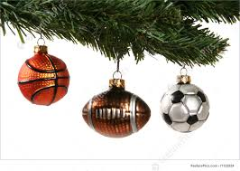 Holidays: A Christmas tree decorated with a football; soccer ball, and  basketball ornaments