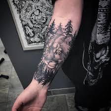 татуировка пумы и леса на предплечье парня фото рисунки эскизы