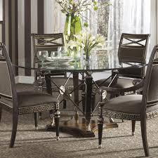 dining room round glass dining table with black wooden base also black leather chair with