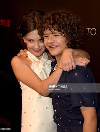 millie bobby brown and gaten matarazzo. millie bobby brown (l) and gaten matarazzo attend netflix\u0027s \u0027stranger things\u0027 for a