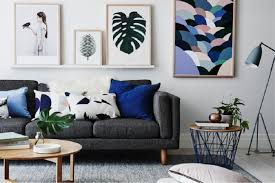 decorating mid century modern living room with stone fireplace paired bohemian sofa pillows area rug and wooden trunk side table antique lamp enchanting mid century modern