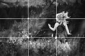girl running in a field using the rule of thirds for composition by