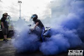 between the time trials and the elimination rounds there was a burnout peion that elyse entered on the engle motors gray bike