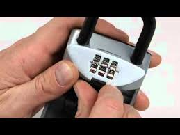 Operating the <b>Master Lock 5406D</b> SafeSpace® Portable Lock Box ...