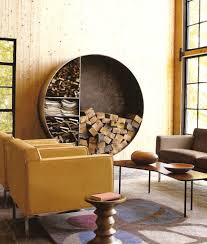 small rustic living room design with floating circle indoor firewood rack and yellow leather chairs and brown sofa ideas