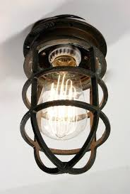 sold antique industrial cast bronze cage light fixture for wall or ceiling signed oceanic fixtu d55