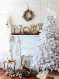 white tree with soft pastel ornaments and natural pinecones for balanced  decor