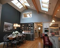 kitchen lighting ideas vaulted ceiling with pendant lamps and skylights also recessed lights