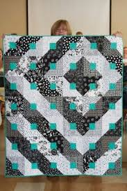 clever layout/color choices for what looks like a basic barn ... & Cool idea for black & white with a pop of color. Pattern for this quilts is  called Paradigm Shift, Designed by Janelle Cedusky and featured in The  McCall's ... Adamdwight.com