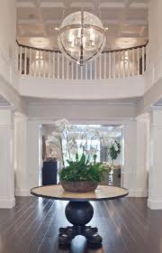 this two story foyer is simply elegant we love the chandelier in particular from