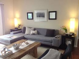 grey and brown furniture. Furniture. Accent Wall With Brown Furniture Grey Fabric Sofa On The Floor And Black H