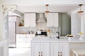 classic kitchen with ikea quartz kitchen countertops white color stainless steel wall mount range hood and crystal mini pendant lights