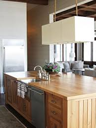 Superior Beach Style Kitchen Idea In Atlanta With Stainless Steel Appliances, A  Farmhouse Sink, Wood
