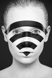 a strikingly beautiful face painted in black and white