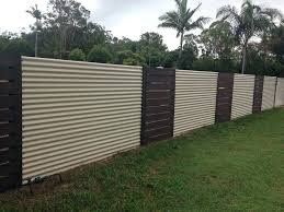 image of corrugated metal fence black
