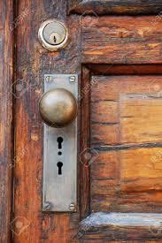 antique door on old wooden door with panels stock photo 3800259