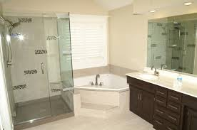 corner combo bathtub in white and cream finished among glass shower stall and brown