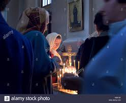 alter lighting. Women Lighting Candels At An Alter In The Orthodox Church Of Holy Spirit Vilnius Lithuania