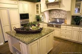 dark granite countertops with white cabinets