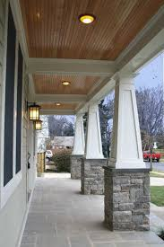 exterior columns for houses for sale. ceiling and floor craftsman tapered columns with stone, cornices, no railing, bluestone porch, green siding stone veneer anthony street house - robert exterior for houses sale t