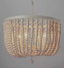 wood beaded chandelier wonderful corinne parts white beam diy for wooden beaded chandelier uk
