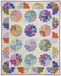"""Laura Nownes pattern w/ fabrics by Kate Spain (Moda) and ... & this pattern """"Sweet Rolls"""" : quilt made using the Offset Log Cabin block :  one wide jelly roll & one wide honey bun set Adamdwight.com"""
