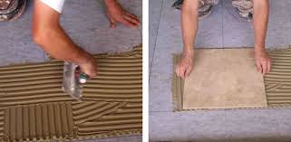 Set tile in adhesive.
