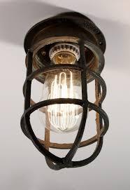 antique cast bronze cage light fixture for wall or ceiling signed oceanic preservation station nashville tn