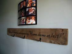 furniture enchanting barnwood diy wall coat rack with welcome sign and black photo frame on white living room wall interior design ideas attractive diy barn wood ideas