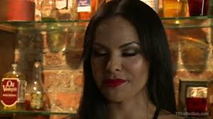 TS Foxxy in Tell Mama Bartender Seduces Sad Sack Patron with Her.