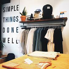 wall mounted clothing rack with top shelf