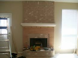 the original fireplace mantle was made out of three sizes of pink brick that were stacked up on top of each other it was a pretty horrible sight