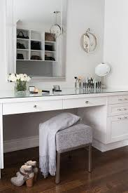 modern mirrored makeup vanity. Chic Dressing Room Features A Built-in Makeup Vanity Topped With Mirror Paired Gray Modern Stool Placed Under Beveled Mirror, Lit By Ring Wall Mirrored E