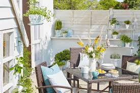 Cozy swing chairs garden ideas Porch Swings Keep It Light Loveproperty Stylish But Simple Small Garden Ideas Lovepropertycom