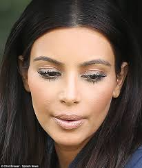 too much kim kardashian worethick makeup as she arrived to khloe s house on tuesday