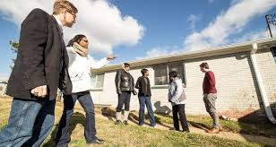 chcs director stephen sills and josie williams of the greensboro housing coalition walk a group through the cote grove neighborhood pointing out issues