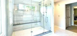close up of the beveled subway tiles see intentional floor slope on bottom tile shower ideas