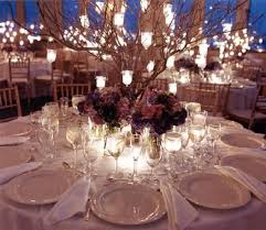 I kinda love the idea of hanging lil tea lights from branches used in the  centerpiece. Wedding ...