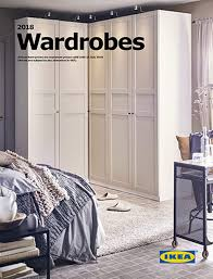 ikea furniture catalog. A Green Wadrobe Against Graphic Black And White Patterned Wall With One Of Its Doors Ikea Furniture Catalog