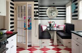 you might want to use a red white checkerboard tile for your kitchen floor adding black stripe wallpaper gives it a design style also simple to do