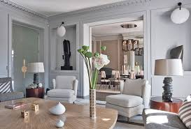 Architect and designer Jean-Louis Denoit calls the living room of this  Paris pied--terre an ode to gray. Image by Xavier Bejot, courtesy of  Rizzoli.