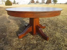 round mission oak dining table with a nice quarter sawn oak top and 3 quarter sawn leaves the solid top measures 52 diameter