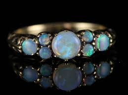sweetness becomes personified in this ring adorned with seven beautiful opals of gorgeous fire this item has already been sold and is no longer