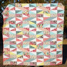 Patchwork Quilting for Beginners: Patterns to Try & Helpful Tips & patchwork quilt with rectangles and triangles Adamdwight.com