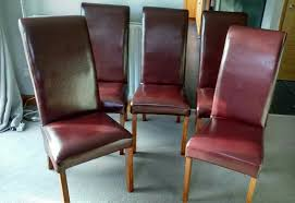 dining room chairs 5 chestnut coloured leather oak legs
