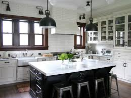 traditional white kitchen with subway tile walls