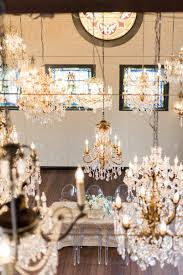 perhaps the perfect destination for a wedding ceremony no well after this styled shoot at the chandelier barn at lionsgate event center