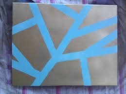 Spray painting canvases is extremely easy. To make cool designs and create  contrasting colors all you need is: -Spray Paint of your choice -Painter's  Tape