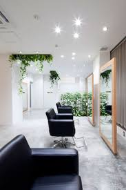 Biophilic hair design Hair Salon Design: Comfort and Relaxing Atmosphere :  Black Comfortable Chairs In Appealing Hair Salon Interior